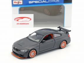 BMW M4 GTS mat zwart met oranje velgen 1:24 Maisto