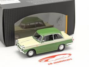 Triumph Herald 1200 grøn / fløde hvid 1:43 Cararama