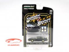 Pontiac Trans Am Film Smokey and the Bandit II 1980 preto / ouro 1:64 Greenlight