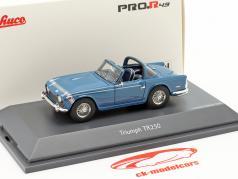 Triumph TR250 Surrey-Top blauw 1:43 Schuco