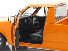 Volkswagen VW Caddy MK1 Bouwjaar 1982 oranje 1:18 Solido