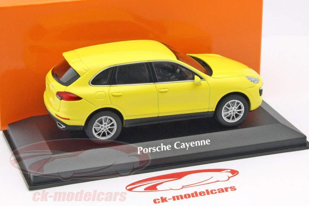 Porsche Cayenne jaar 2014 geel 1:43 Minichamps