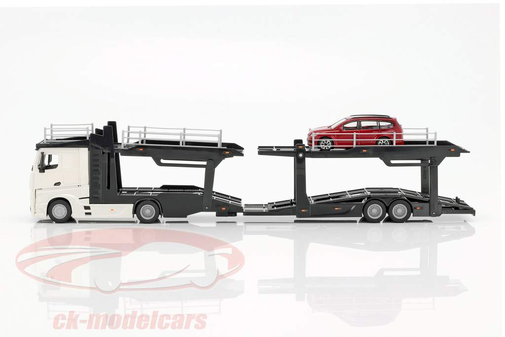 Mercedes-Benz Actros Multicar Carrier and Ford Focus white / red 1:43 Bburago