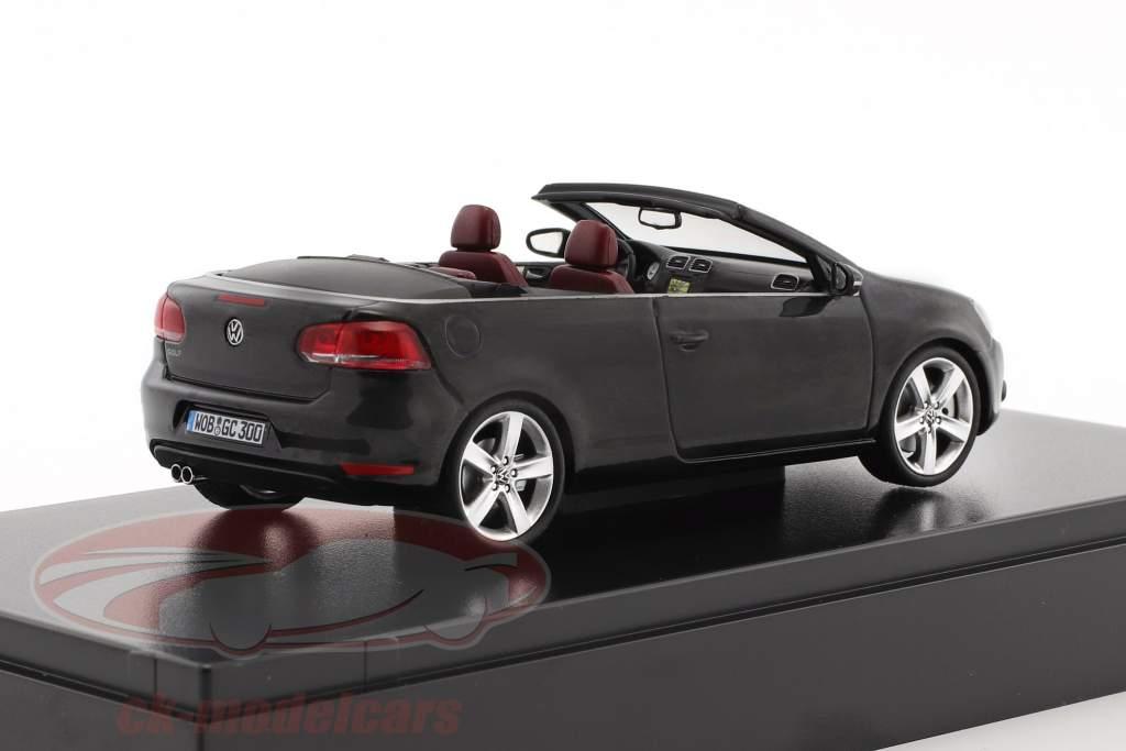 Volkswagen VW Golf Cabriolet Baujahr 2012 schwarz mit roten Sitzen 1:43 Schuco