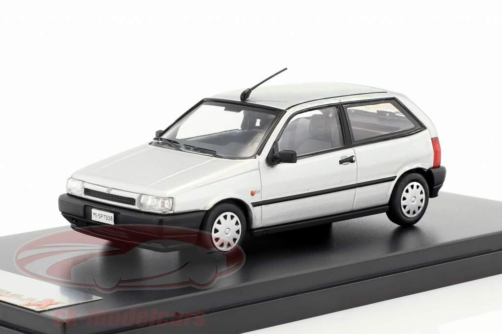Fiat Tipo 3-deurs Bouwjaar 1995 zilver 1:43 Premium X