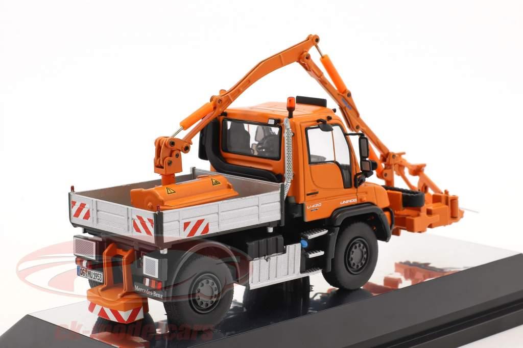 Mercedes-Benz Unimog U 400 / Mulag MKM 700 con falciatore arancione 1:50 NZG