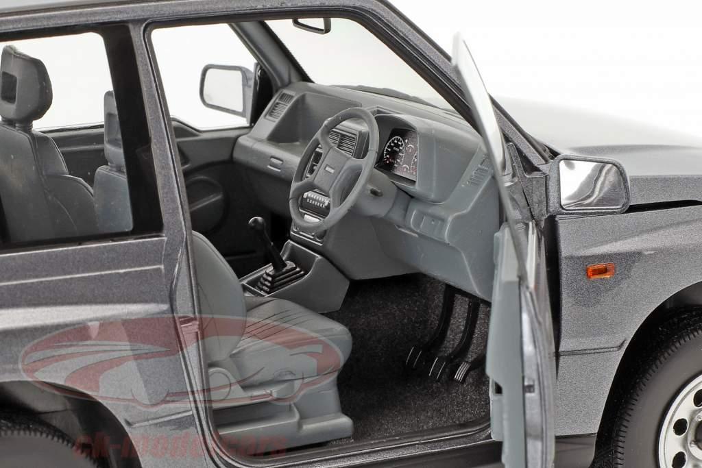 Suzuki Vitara / Escudo RHD grigio 1:18 Dorlop