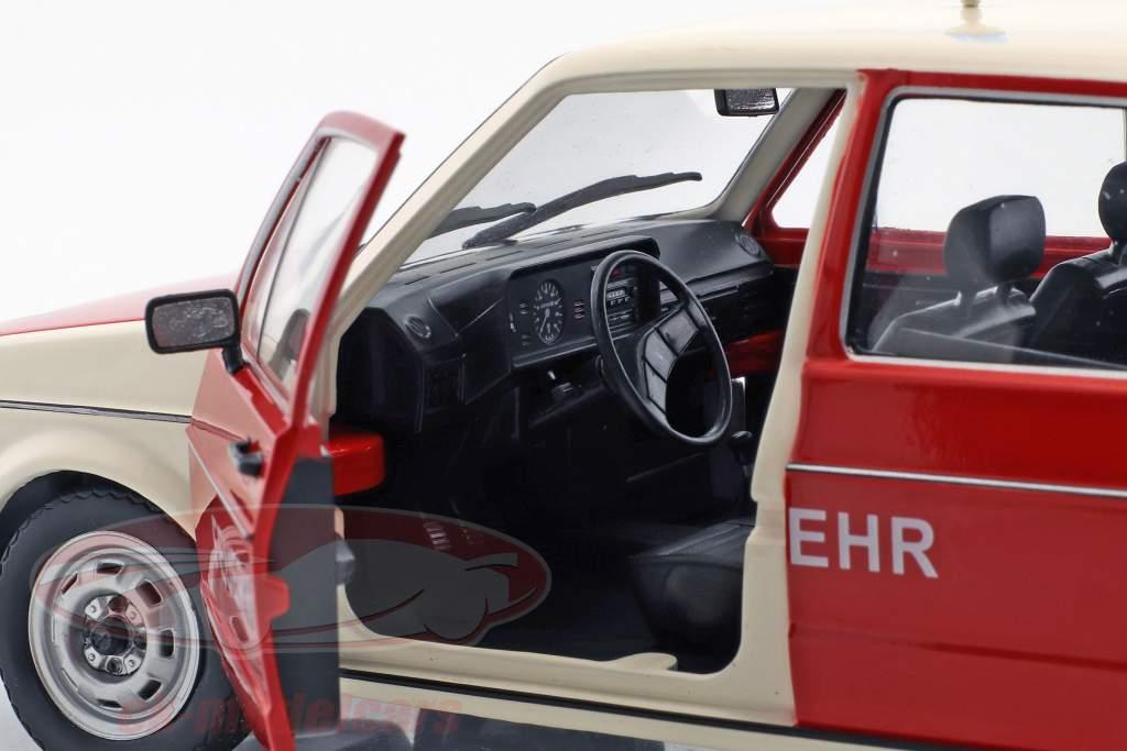 Volkswagen VW Golf fire department red / beige 1:18 Solido