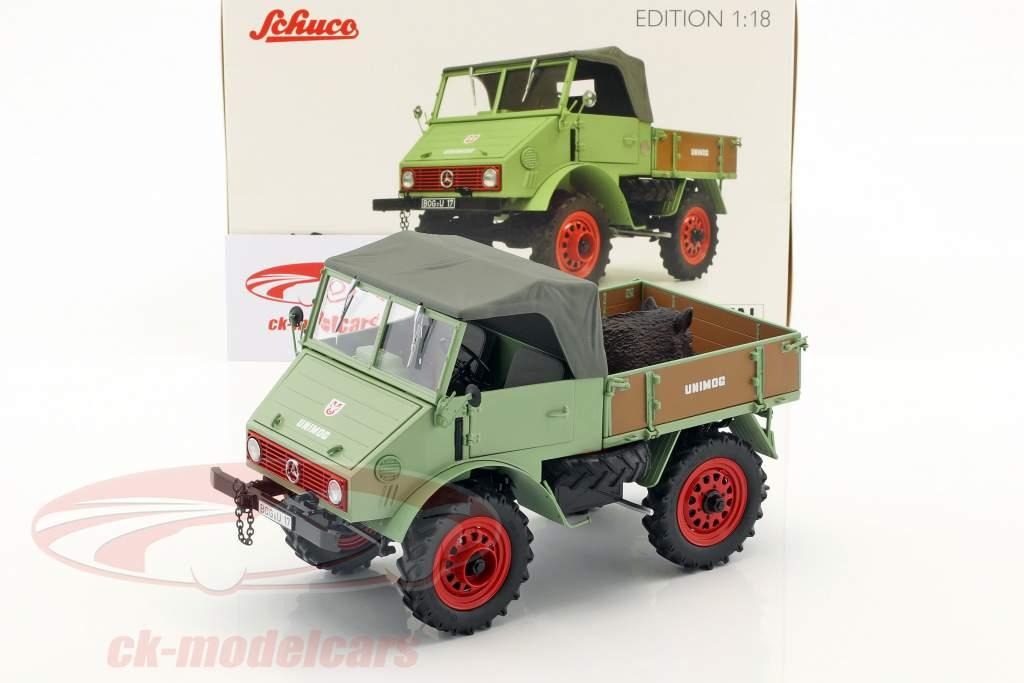 Mercedes-Benz Unimog 401 with wild boar green 1:18 Schuco