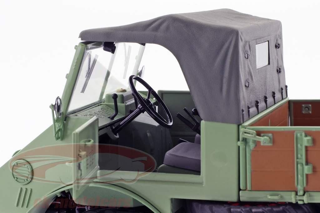 Mercedes-Benz Unimog 401 con cinghiale verde 1:18 Schuco