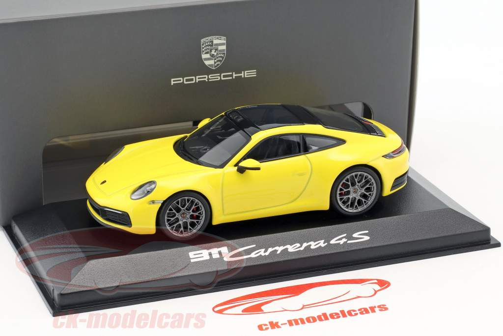 Porsche 911 (992) Carrera 4S coupe Bouwjaar 2019 racing geel 1:43 Minichamps