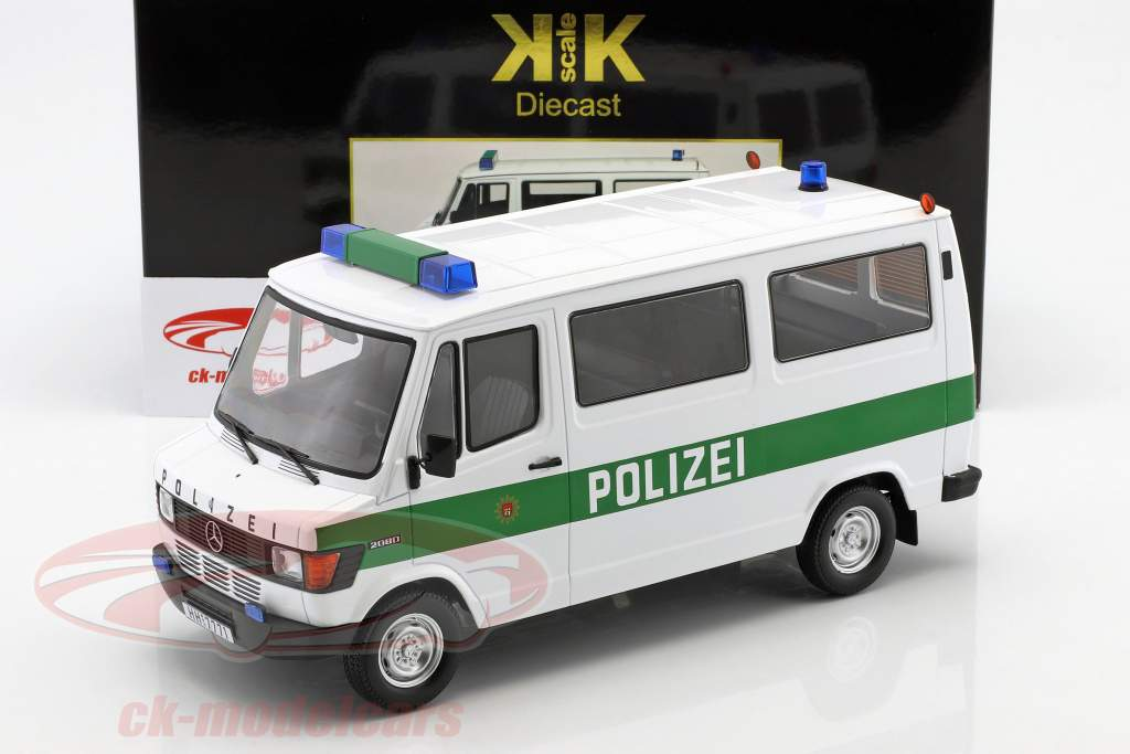 Mercedes-Benz 208 D Bus politie Bouwjaar 1988 wit / groen 1:18 KK-Scale