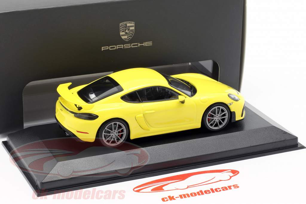 Porsche 718 (982) Cayman GT4 Jaar 2019 geel 1:43 Minichamps