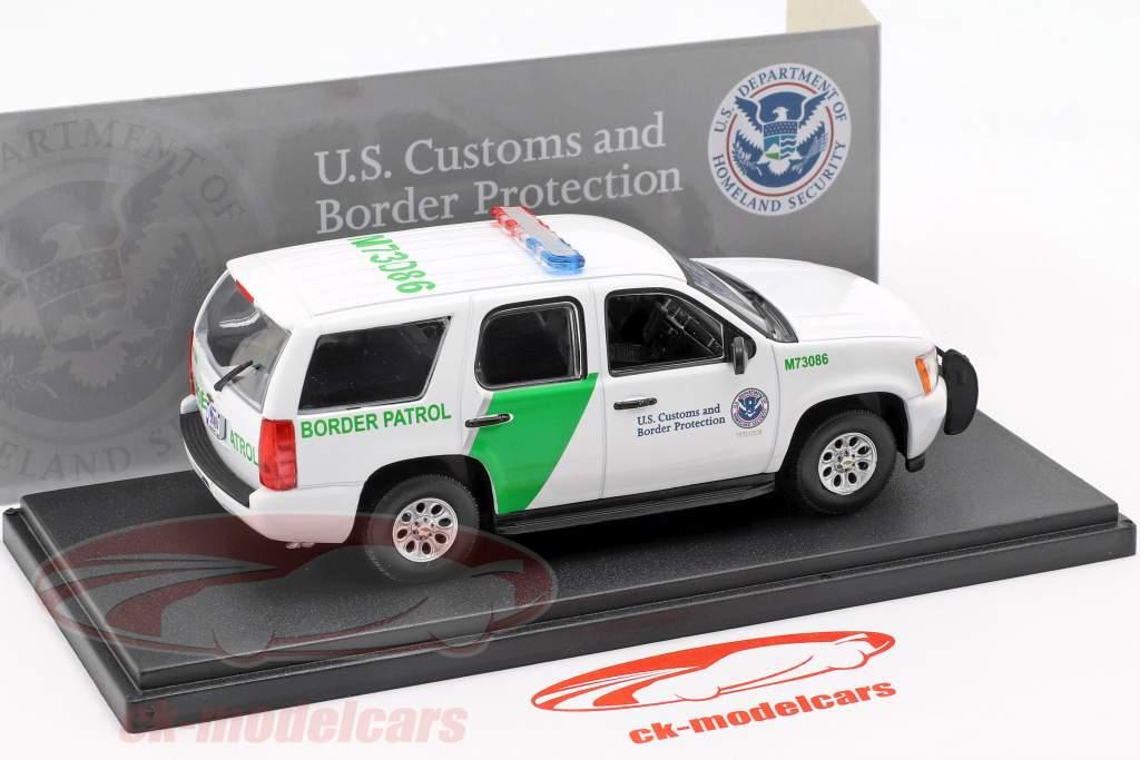 Chevrolet Tahoe fronteira patrulha ano de construção 2010 branco / verde 1:43 Greenlight