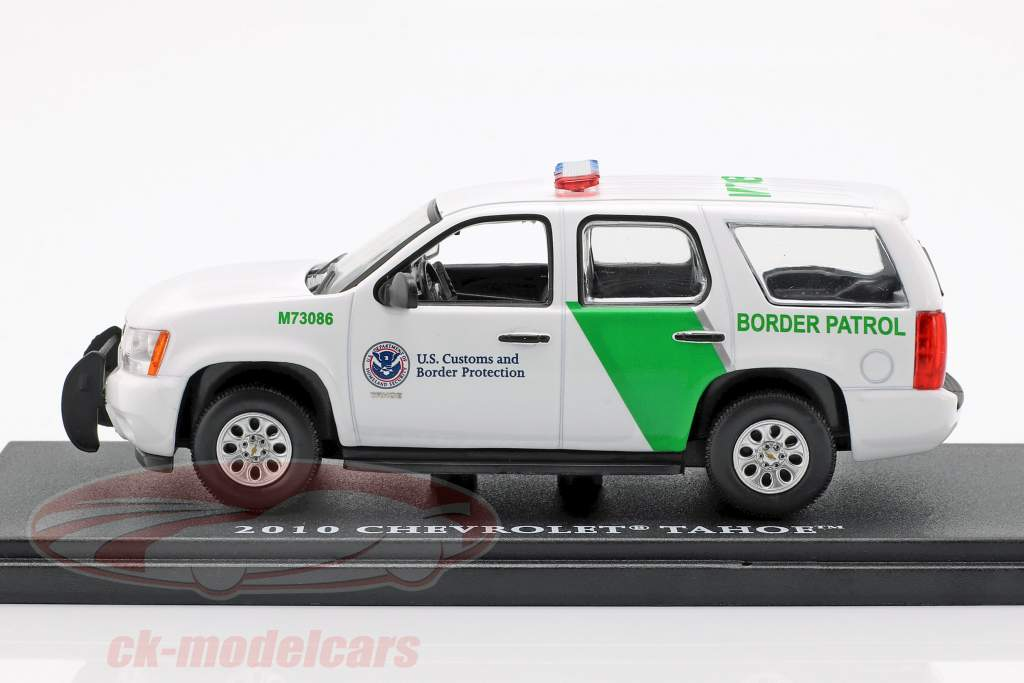 Chevrolet Tahoe Border Patrol year 2010 white / green 1:43 Greenlight