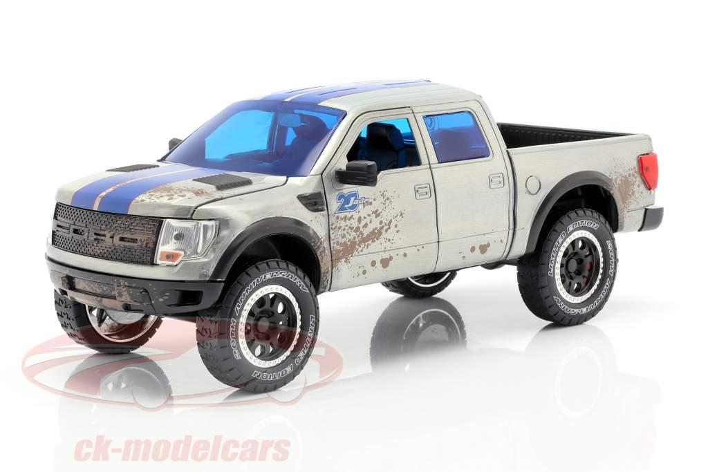 Ford F-150 SVT Raptor construido en 2011 gris plateado / azul 1:24 Jada Toys