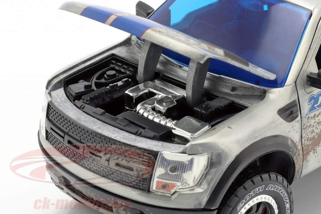 Ford F-150 SVT Raptor construído em 2011 silvergrey / blue 1:24 Jada Toys