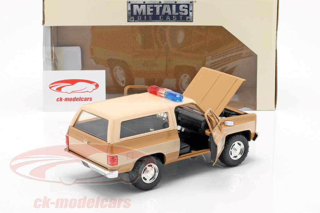 Hopper's Chevy Blazer con distintivo della polizia serie TV Stranger Things marrone / beige 1:24 Jada Toys