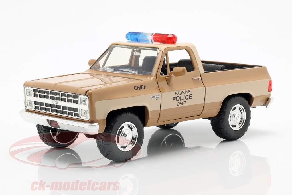 Hopper's Chevy Blazer With Police badge TV series Stranger Things brown / beige 1:24 Jada Toys