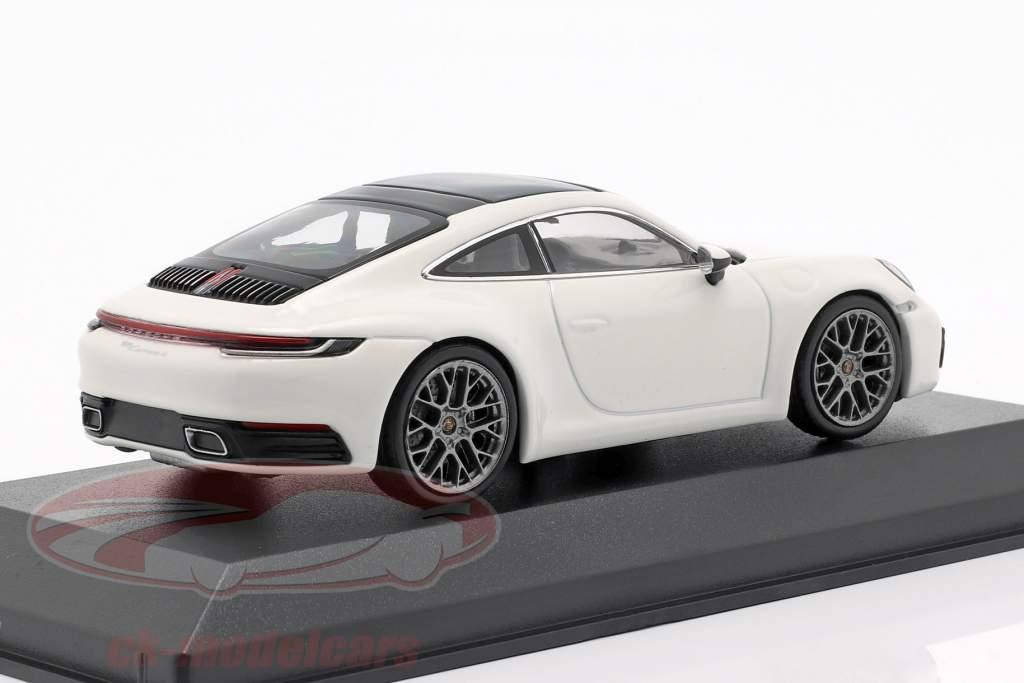 Porsche 911 (992) Carrera 4 weiß / schwarz 1:43 Minichamps