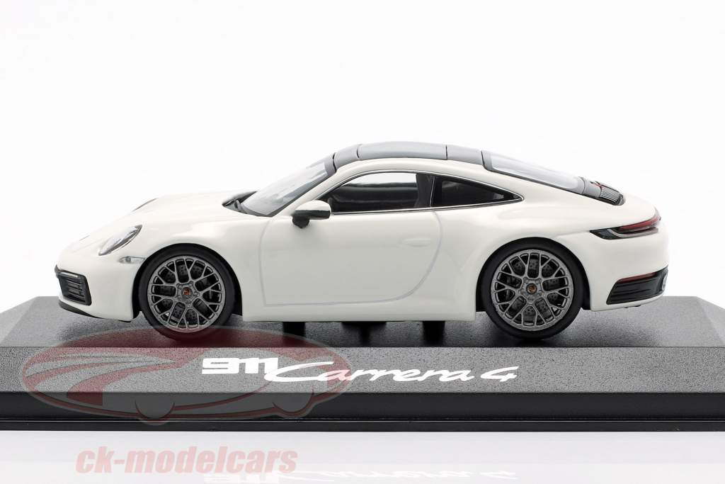 Porsche 911 (992) Carrera 4 white / black 1:43 Minichamps