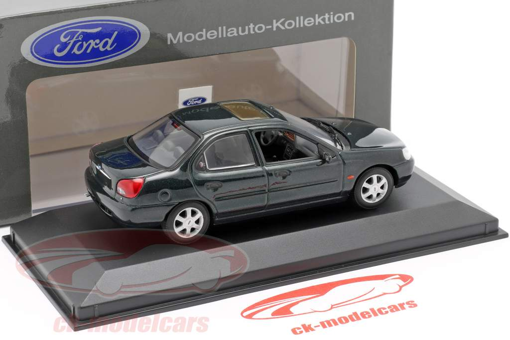 Ford Mondeo Limousine år 1996 mørkegrøn metallic 1:43 Minichamps