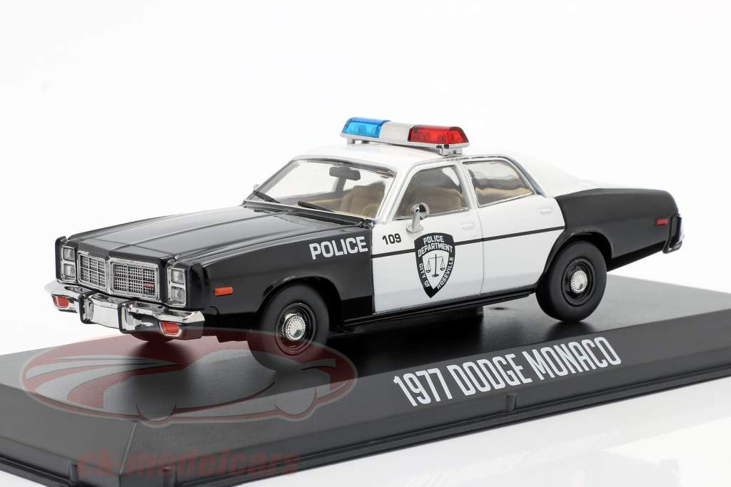 Dodge Monaco Police Année de construction 1977 noir / blanc 1:43 Greenlight