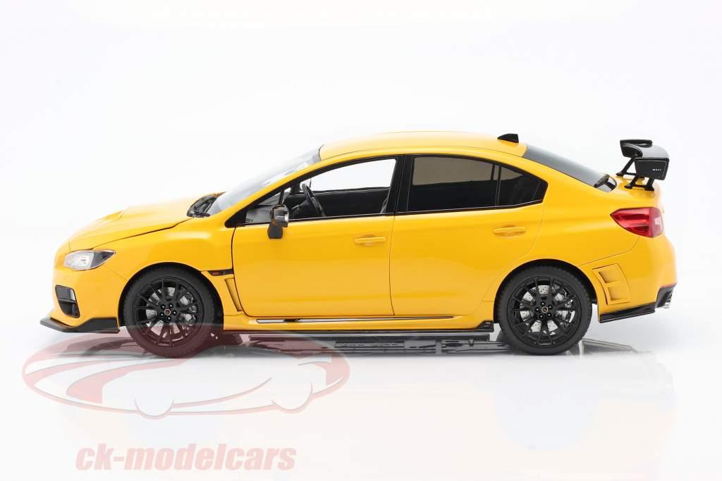 Subaru S207 NBR Challenge Package jaar 2015 geel 1:18 SunStar