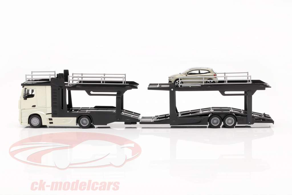Mercedes-Benz Actros transportador de carro com VW Polo GTI ouro / preto / cinza metálico 1:43 Bburago