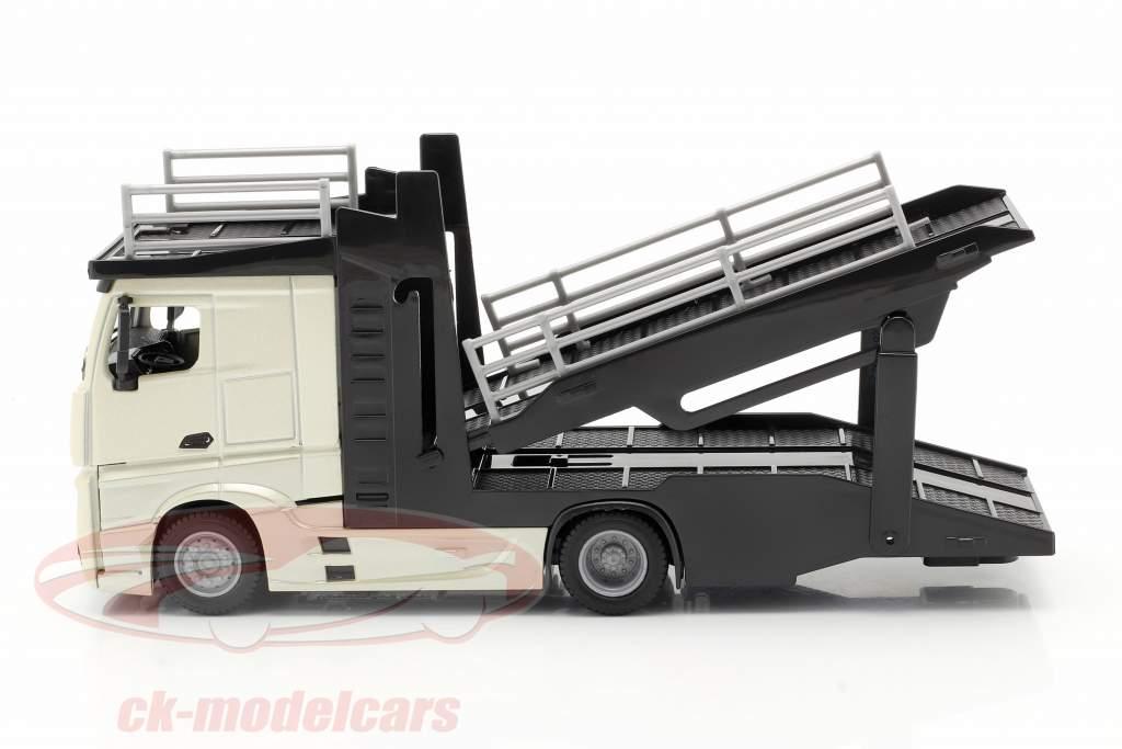Mercedes-Benz Actros transporteur de voitures avec VW Polo GTI or / noir / gris métallique 1:43 Bburago