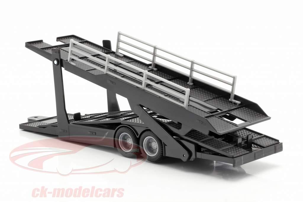 Mercedes-Benz Actros Autotransporter mit VW Polo GTI gold / schwarz / grau metallic 1:43 Bburago