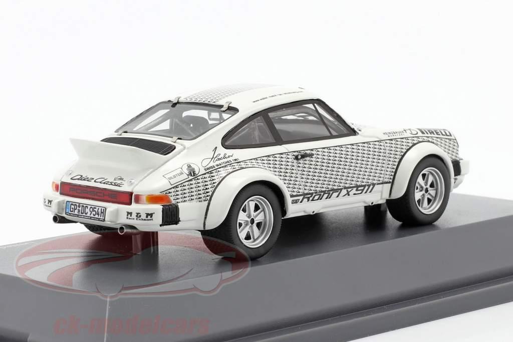 Porsche 911 Walter Röhrl x911 Wit / zwart 1:43 Schuco
