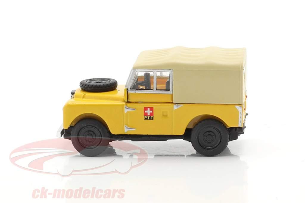 Land Rover 88 PTT geel 1:87 Schuco