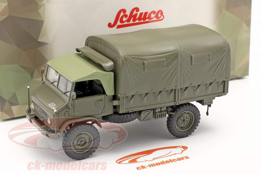 Mercedes-Benz Unimog 404 S Pritschenwagen mit Plane Militärfahrzeug oliv 1:35 Schuco