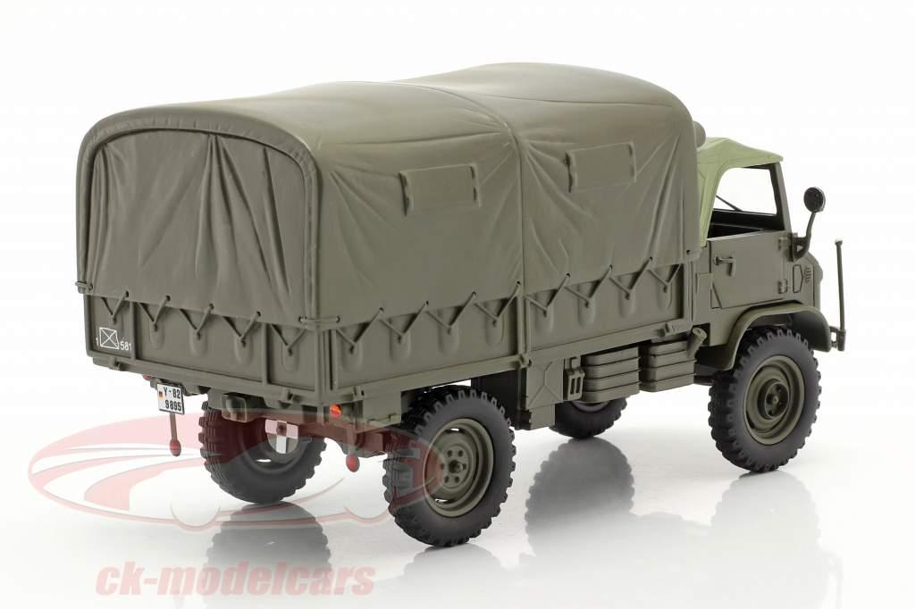 Mercedes-Benz Unimog 404 S Caminhonete Com Planos Veículo militar Oliva 1:35 Schuco