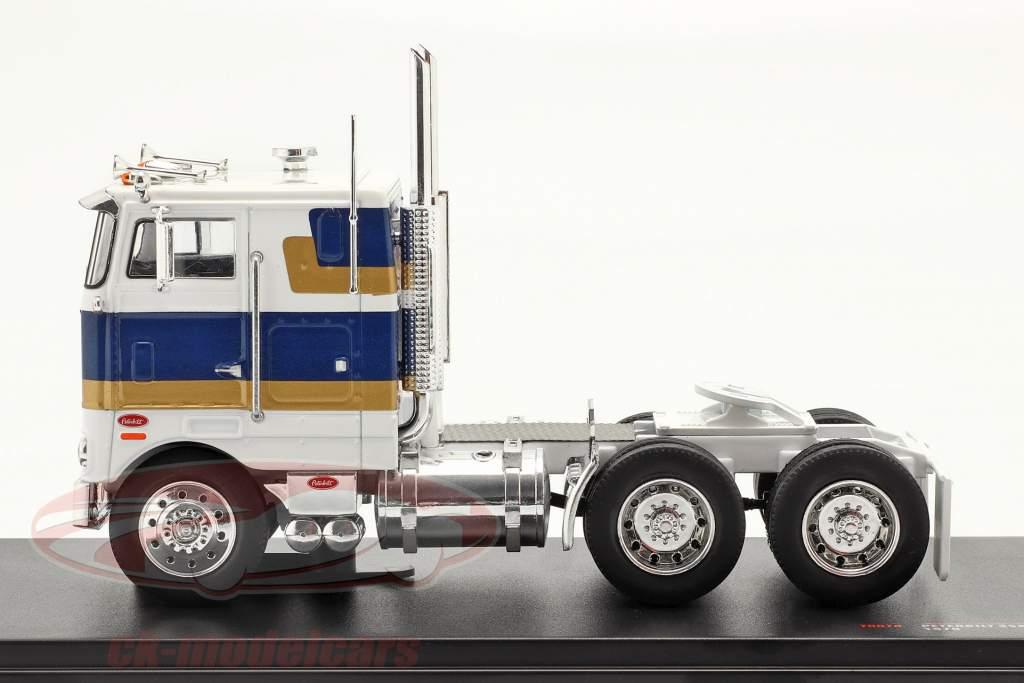 Peterbilt 352 H Sattelzugmaschine 1979 weiß / blau / gold 1:43 Ixo