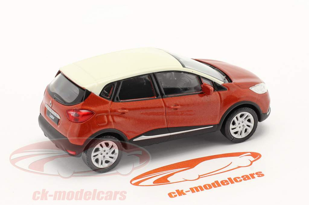 Renault Captur bouwjaar 2013 donker oranje metalen / wit 1:43 Norev