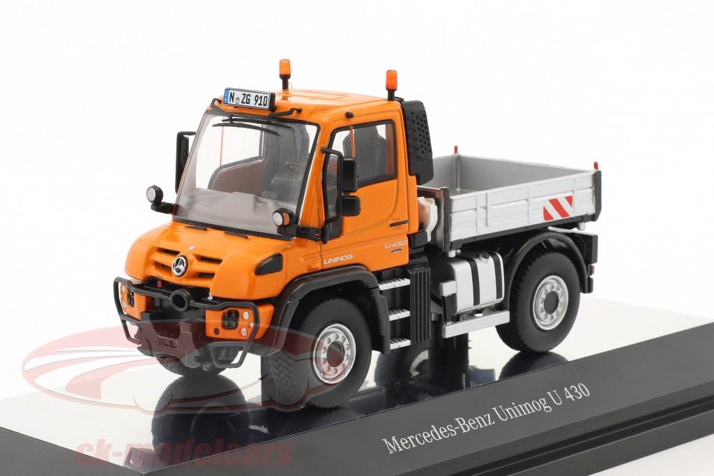 nzg-1-50-mercedes-benz-unimog-u-400-mit-pritsche-orange-silber-910-65/