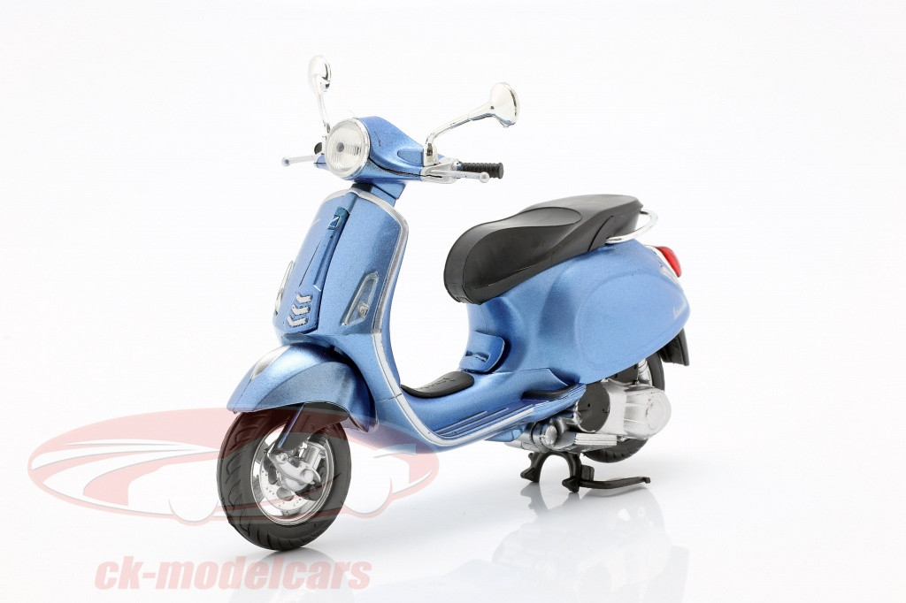 newray-1-12-vespa-primavera-lumiere-bleu-metallique-57553/