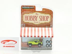 Jeep Wrangler YJ Baujahr 1991 gelb mit Wheel and Tire Set 1:64 Greenlight