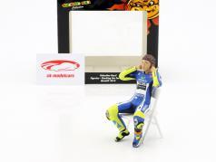 Valentino Rossi figure Checking the ear plugs MotoGP 2014 1:12 Minichamps