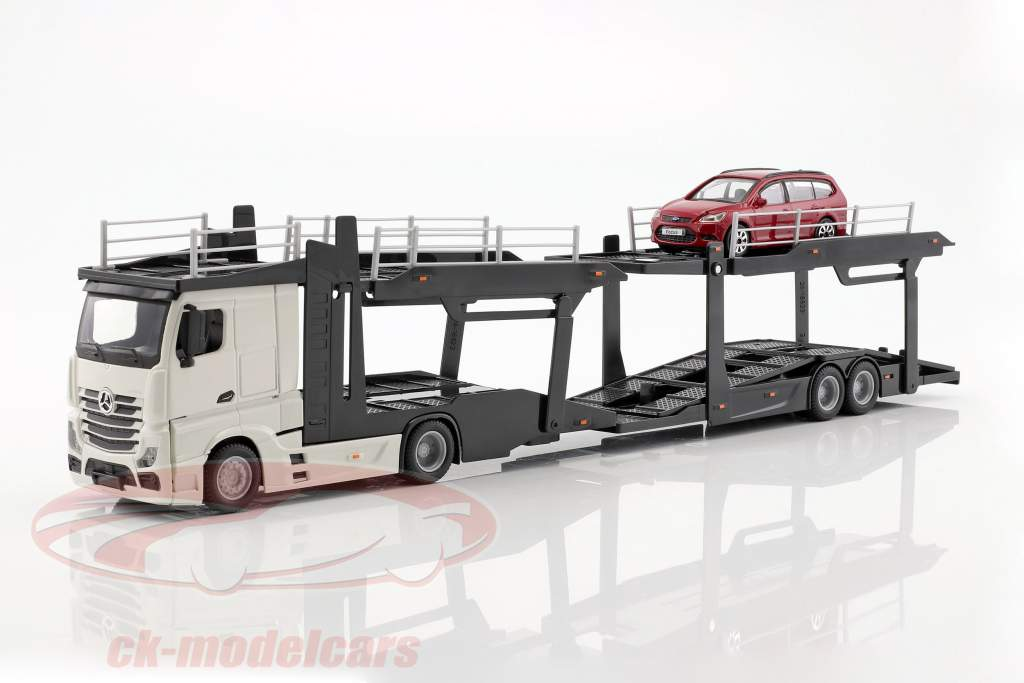 Mercedes-Benz Actros Multicar Carrier et Ford Focus blanc / rouge 1:43 Bburago