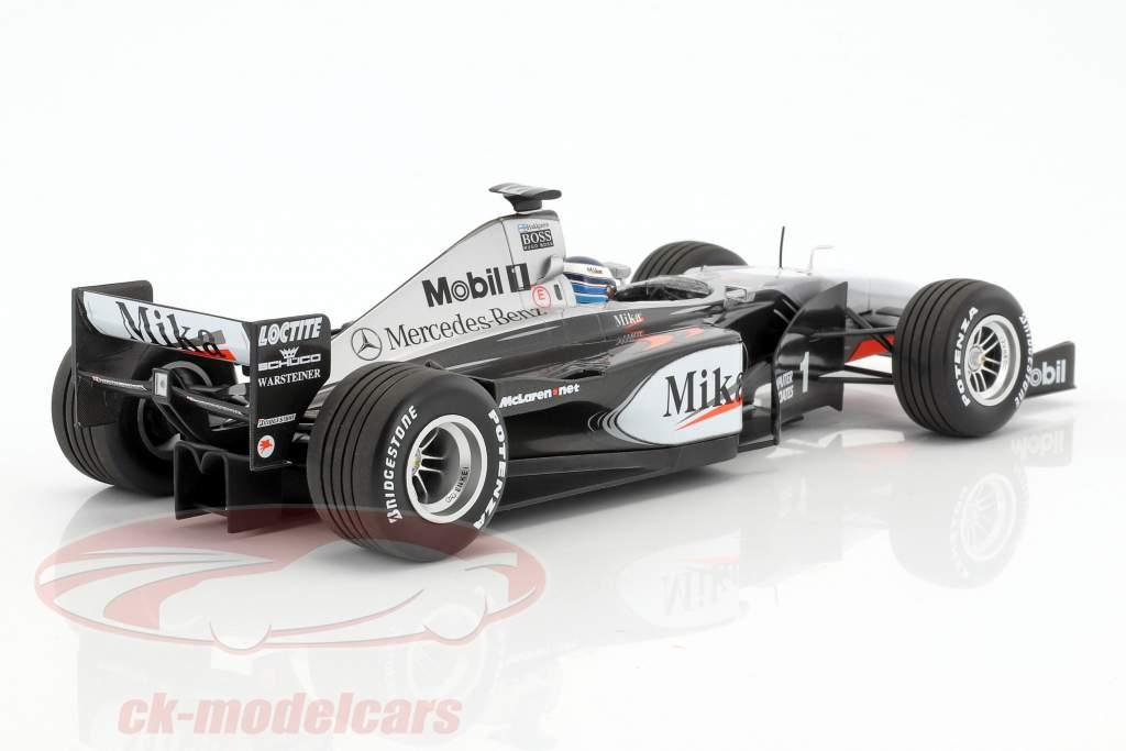 Mika Häkkinen McLaren Mercedes MP4/14 #1 champion du monde formule 1 1999 1:18 Minichamps