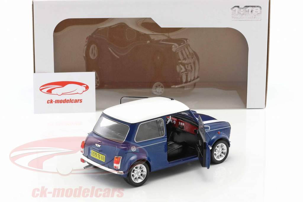 Mini Cooper 1.3i Sport Pack year 1997 blue metallic / White 1:18 Solido