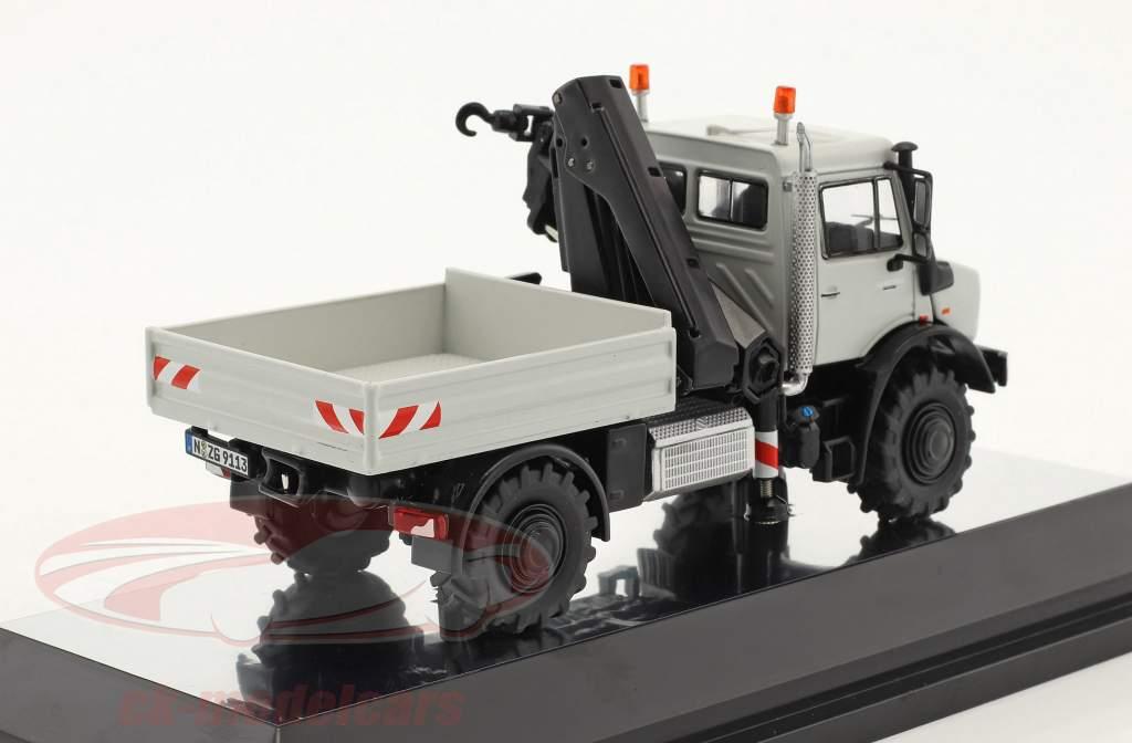 Mercedes-Benz Unimog U 5000 camion piattaforma con gru grigio 1:50 NZG